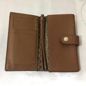 Coach Accessories - coach phone wallet with card slots.